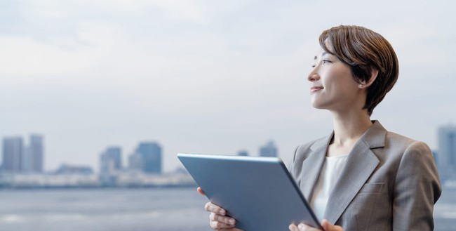 Businesswoman holding a tablet PC.